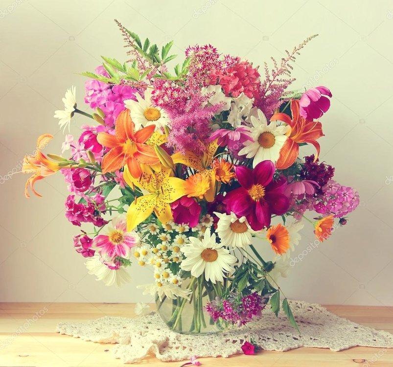 depositphotos_79646244-stock-photo-bouquet-from-cultivated-flowers-in.thumb.jpg.7ac943ceb5fbdf8eea8a3ece9c6eb7cf.jpg